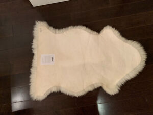 Sheep skin rug. Never used
