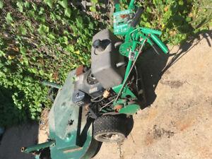 Self propelled walk behind commercial mower.  Needs repair