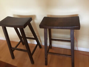 Two backless wooden bar stools for sale