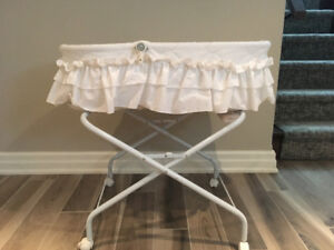 white bassinet with stand