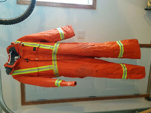 Helly Hansen insulated coveralls model f386 size 44 with hood.