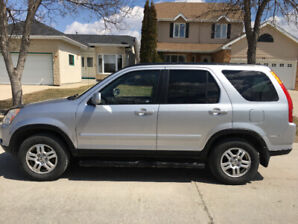 Honda Crv 2003 With safety, if the ad is up it is available