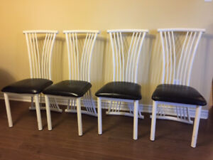 Four metal chairs for sale! Easy to clean!