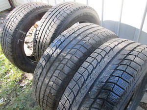 4 Michelin winter tire 235 60 18 almost new/quasiment neuf