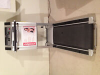 NEW, NEVER BEEN USED TREADMILL