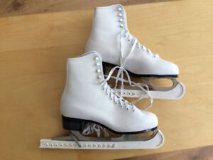 Figure Skates for sale with blade protectors