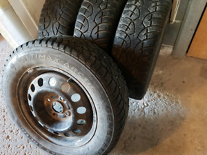 set of 185/65/14 winter tires WITH rims