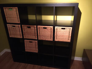 Black IKEA shelving unit with five storage boxes
