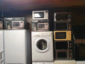57. Brand new and second hand microwaves