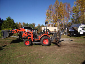 Kioti tractor with backhoe and trailer to haul