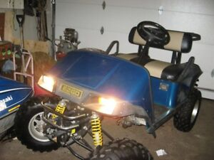 lifted EZ-GO electric golf cart
