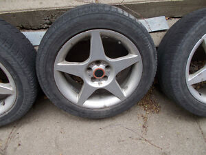 4 Tires and rims from a Subaru
