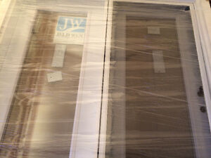 Two new Garden doors for sale 1,000.00 each or best offer.