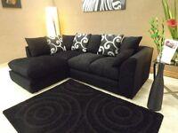 Brand new Fabric material Corner sofa plain black with swirl cushions