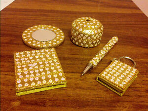 Matching golden heart set of little notepads, pen, mirror, box