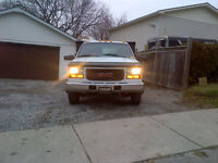1997 GMC Sierra 3500 FLATBED WITH FOLD DOWN SIDES