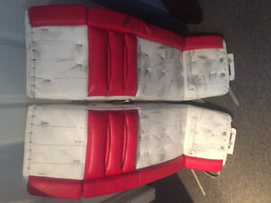 Simmons red and white goalie pads