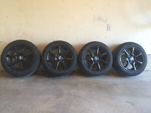 "4 black 16"" rims with Michelin X-Ice Winter Tires 205/55R16"
