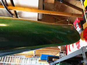 Canoe... old fiberglass, sturdy... has been repaired