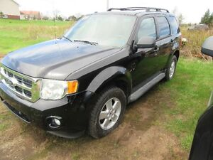 2009 Ford Escape XLT no rust only 124 km  new  tire  new  mvi