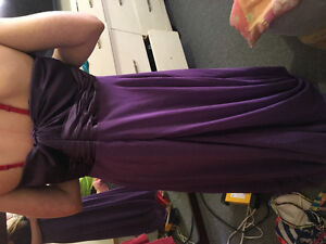 Two beautiful prom dresses ones a large and ones a medium