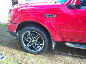almos new tires and custom rims