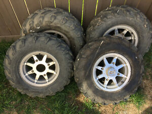 Front and rear tires and rims for polaris sportsman.