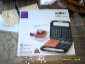 This is a Brand New Salton Belgian Waffle Maker.