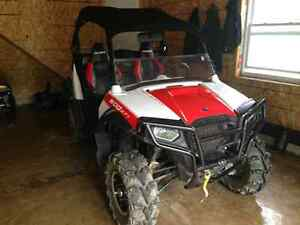 I am selling my 2012 Polaris Rzr 800 red and white, with soft to