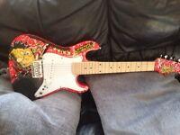 SpongeBob electric guitar. Comes with case tutorial DVD