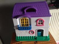 Small dolls house has lots of furniture bits inside