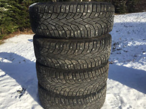 Four 235/65R17 Studded Winter Tires