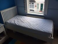 Feather and black Oxford single bed with mattress