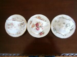 THREE PRETTY PARAGON CUP AND SAUCER SETS