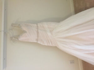 Your stunning brand new never worn wedding gown!