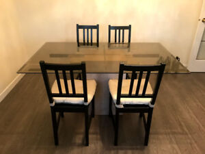 Glass top dining table and 4 chairs for sale