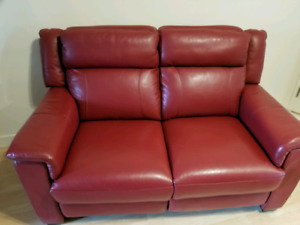Brand new red leather love seat recliner