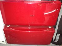 2 red washer/dryer pedestals