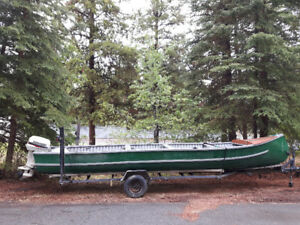 22 foot Teslin Freighter with trailer and Johnson 25