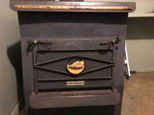 Poêle  à bois ou combustion lente à Ste -Justine
