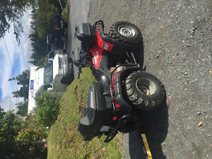 4X4 Honda with plow and trailer.