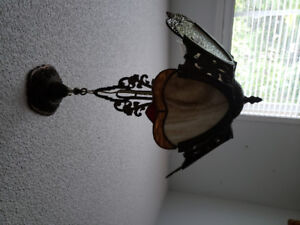 Vintage stained hanging lamp used in a hallway