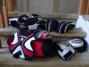 Hockey gloves elbowpads and chest protector
