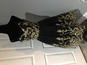 Gorgeous brand new black and gold dress with tags.