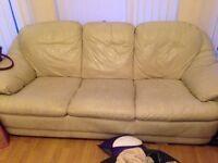 2x cream sofas