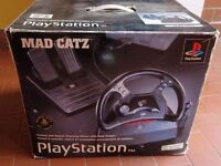 **BOXED MAD CATZ** RACING WHEEL AND REDALS - PS1