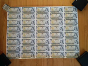 Two uncut sheets of Canadian 1$ bills
