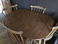 Dark dinning table and 4 chairs