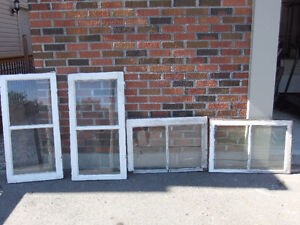 14 various sized vintage storm windows with antique glass