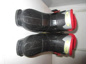 2 pairs of Toddler ski boots.  Fits size 12 shoe